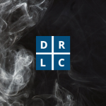 DRLC logo on muted black background with faint smoke.